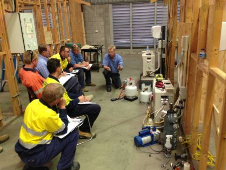 Trainer explanation and demonstration on how to recover refrigerant from an air conditioning split system