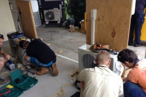 Students working on an air conditioner in our Melbourne split system course