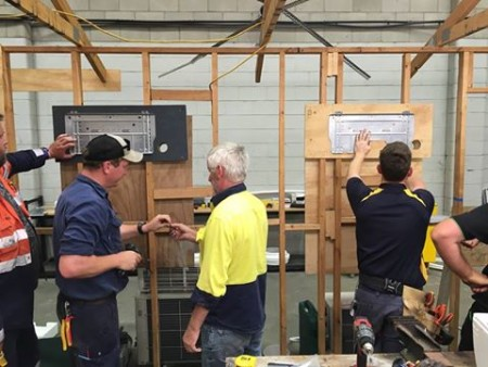 Students mounting air conditioning brackets in our Perth split system course.