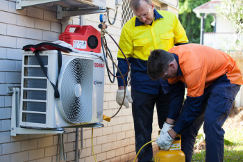 Two students training in person at our Brisbane air conditioning course